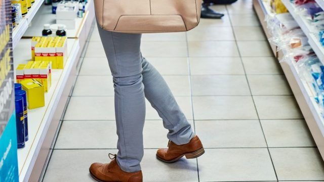 Cropped shot of a female customer in a pharmacy