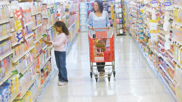 Mother and daughter shopping for groceries in supermarket